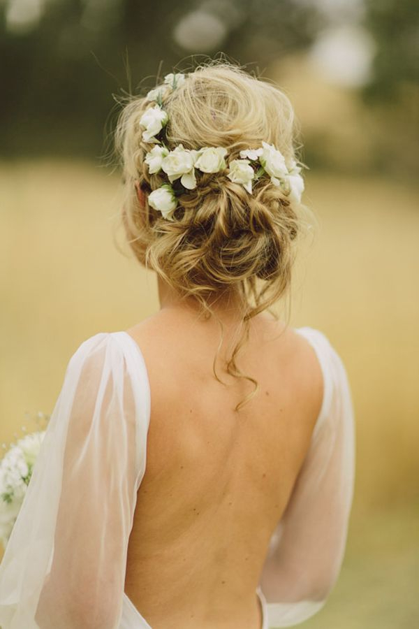 Wedding Hairstyles: 15 Fab Ways To Wear Flowers In Your Hair With Regard To Large Curly Bun Bridal Hairstyles With Beaded Clip (View 21 of 25)