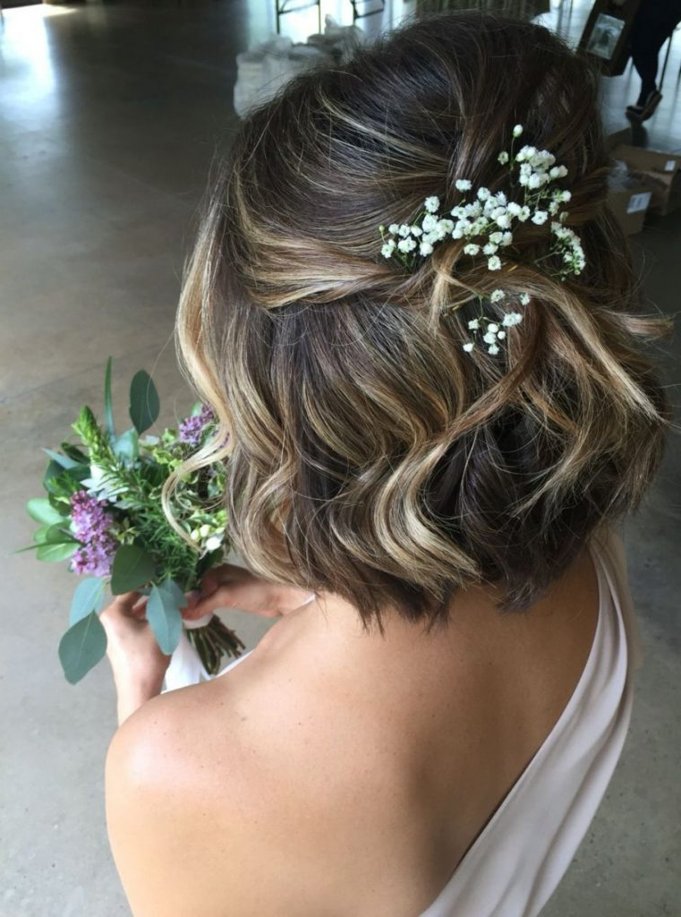 Wedding Hairstyles Low Messy Chignon For Short Hair With Flowers Regarding Low Messy Chignon Bridal Hairstyles For Short Hair (View 22 of 25)