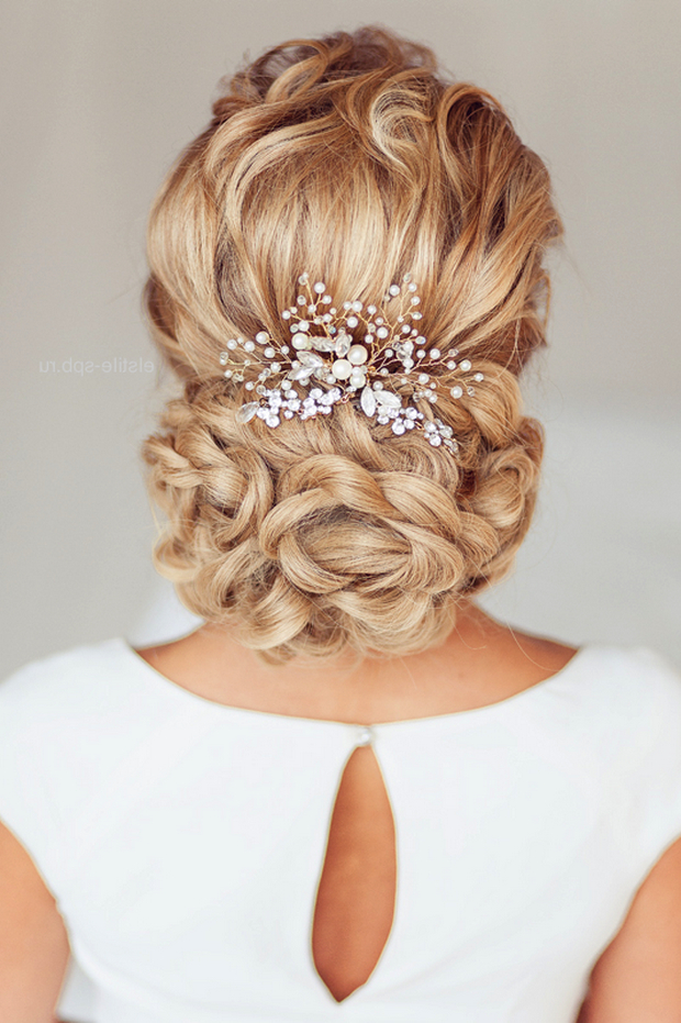 Wedding Hairstyles | Tulle & Chantilly Wedding Blog Intended For Wavy Low Bun Bridal Hairstyles With Hair Accessory (View 9 of 25)