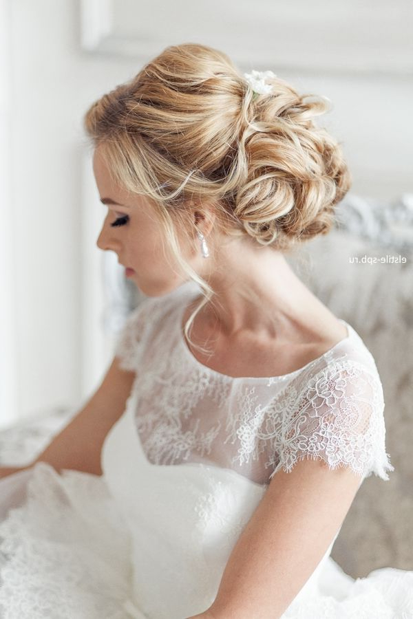 Wedding Hairstyles | Tulle & Chantilly Wedding Blog Regarding Curly Bridal Bun Hairstyles With Veil (View 13 of 25)