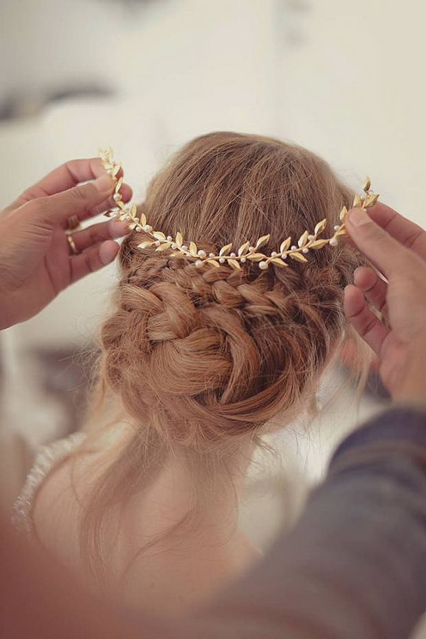 Wedding Hairstyles | Tulle & Chantilly Wedding Blog Within Wavy Low Bun Bridal Hairstyles With Hair Accessory (View 13 of 25)