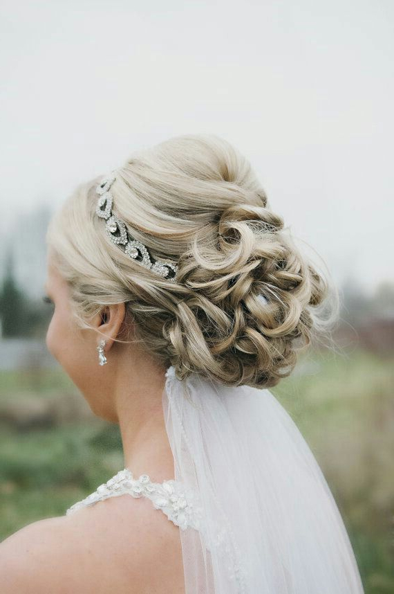 Featured Photo of Bridal Chignon Hairstyles With Headband And Veil