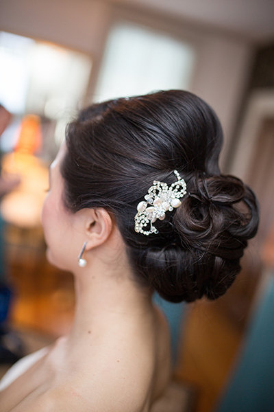 Wedding Updos That Are Beautiful From Every Angle | Bridalguide Intended For Sleek Bridal Hairstyles With Floral Barrette (View 14 of 25)