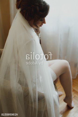 Young Gorgeous Bride Is Sitting In The Room Waiting For Her Groom Inside Tender Bridal Hairstyles With A Veil (View 20 of 25)