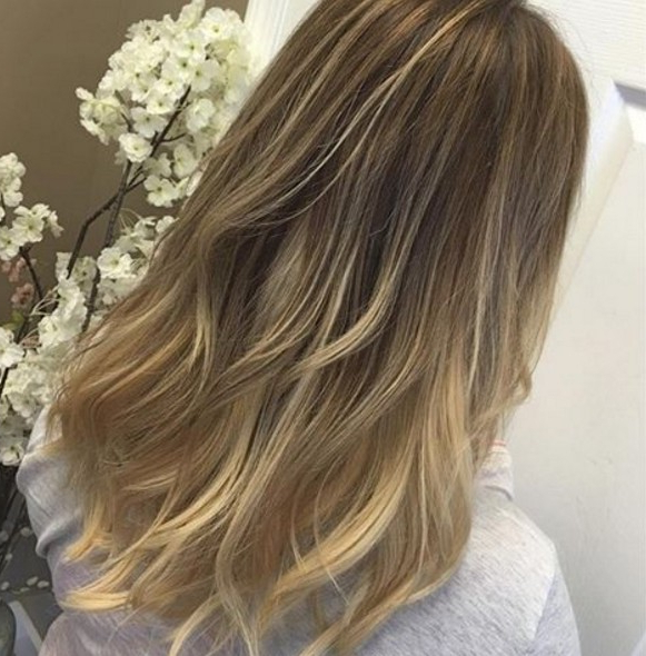 10 Hottest Layered Haircuts For Medium Hair Now – Popular Haircuts Regarding Windswept Layers For Long Hairstyles (View 12 of 25)