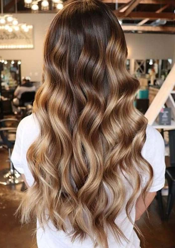 100+ Best Long Wavy Hairstyles – Belletag Regarding Curled Long Hair Styles (View 24 of 25)