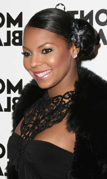 Featured Photo of Side Bun Prom Hairstyles With Black Feathers