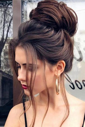 Featured Photo of Messy High Bun Prom Updos