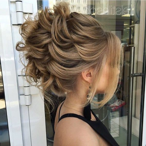 154 Updos For Long Hair Featuring Beautiful Braids And Buns Throughout Messy High Bun Prom Updos (View 14 of 25)
