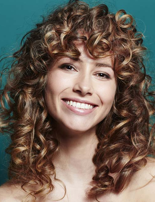 20 Amazing Layered Hairstyles For Curly Hair Pertaining To Curly Long Hairstyles With Bangs (View 7 of 25)