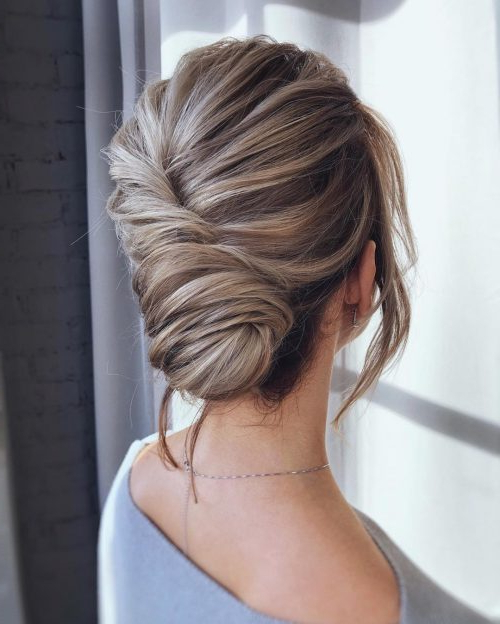 20 Simple Updos That Are Super Cute & Easy (2019 Trends) With Regard To Twisted Side Roll Prom Updos (View 7 of 25)