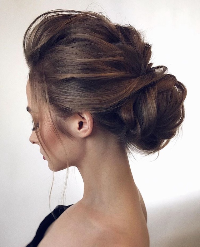 2018 Wedding Hair Trends | The Ultimate Wedding Hair Styles Of 2018 In Messy Bun Prom Hairstyles With Long Side Pieces (View 8 of 25)