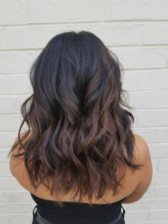 25 Best Warm Black Hair Color Examples You Can Find – Belletag Intended For Warm Toned Brown Hairstyles With Caramel Balayage (View 22 of 25)