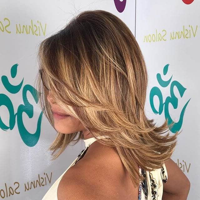 50 Fresh Hairstyle Ideas With Side Bangs To Shake Up Your Style Inside Layered With A Flip For Long Hairstyles (View 11 of 25)