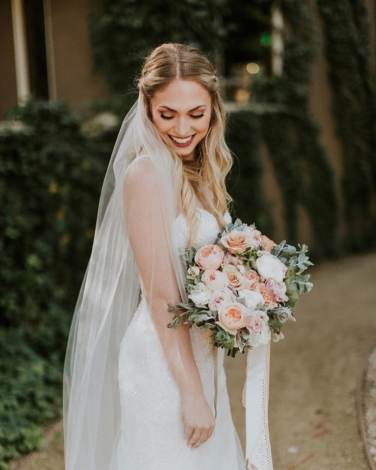 Beach Waves With Middle Part, Side Twists, And Long Veil | Brides Inside Long Hairstyles Veils Wedding (View 20 of 25)