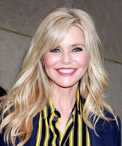 Christie Brinkley Casual Long Wavy Hairstyle With Side Swept Bangs With White Blonde Flicked Long Hairstyles (View 14 of 25)