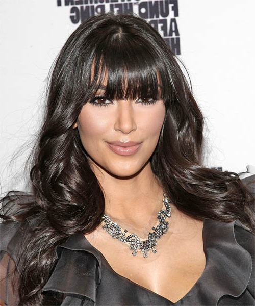Kim Kardashian Casual Long Wavy Hairstyle With Blunt Cut Bangs Throughout Kim Kardashian Long Hairstyles (View 13 of 25)