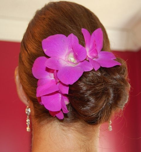 Featured Photo of Side Bun Prom Hairstyles With Orchids