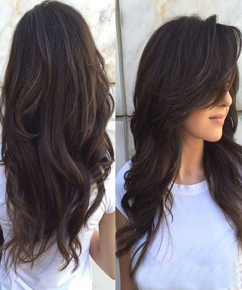 Featured Photo of Messy Loose Curls Long Hairstyles With Voluminous Bangs