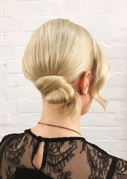Side Bun Hairstyles: 9 Inspirational Updos For Any Occasion | All Regarding Side Bun Prom Hairstyles With Jewelled Barrettes (View 13 of 25)
