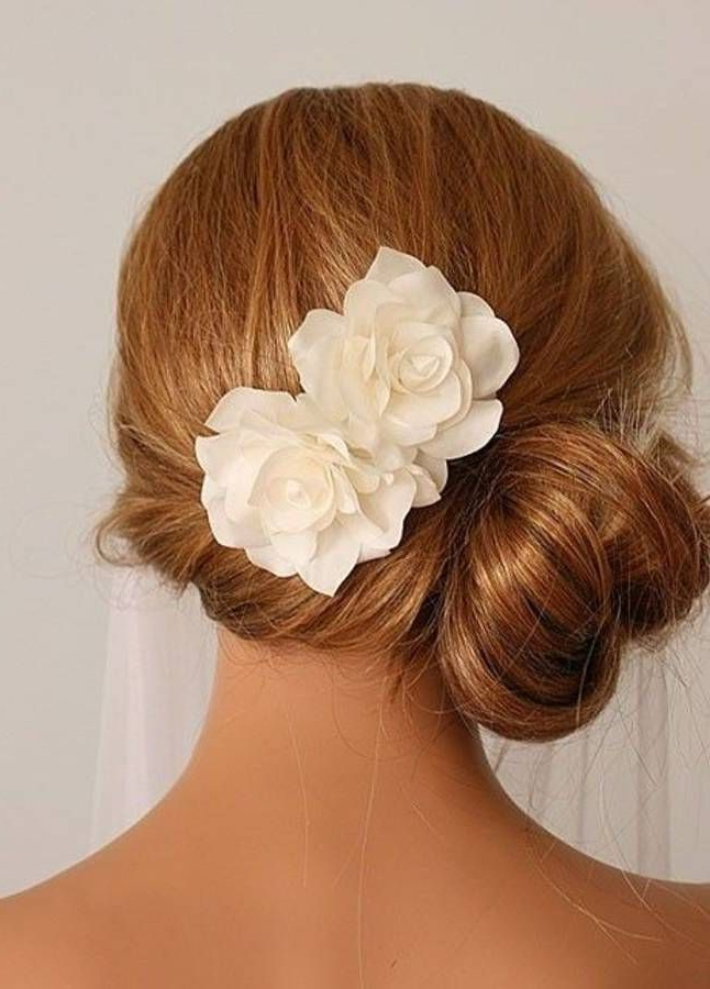 Side Bun With Flower Bridesmaid Hairstyles For Long Hair– Minus In Side Bun Prom Hairstyles With Orchids (View 3 of 25)
