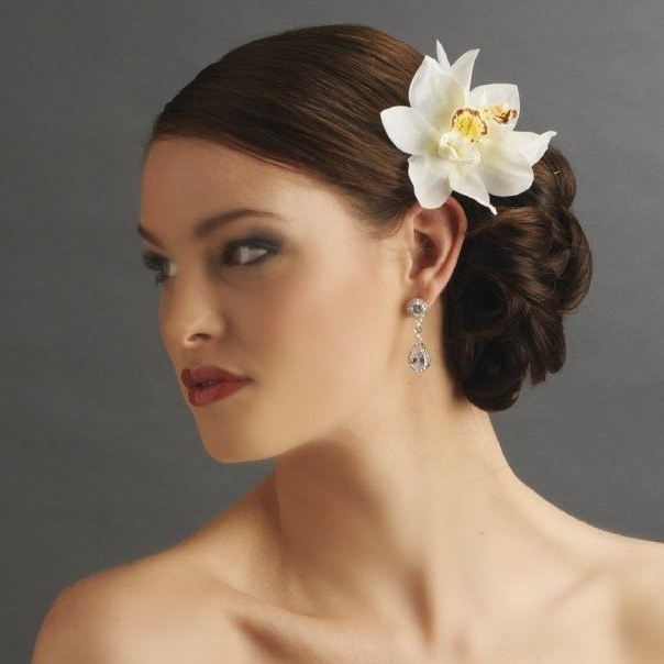 Side Bun With Orchid Pin   Wedding Ideas   Bridal Hair Flowers Within Side Bun Prom Hairstyles With Orchids (View 4 of 25)