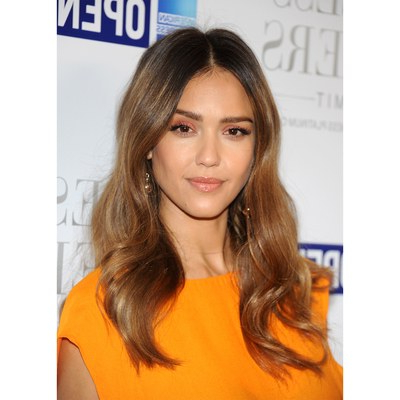 The 10 Most Flattering Haircuts For Oval Faces | Allure In Long Layered Waves And Cute Bangs Hairstyles (View 25 of 25)