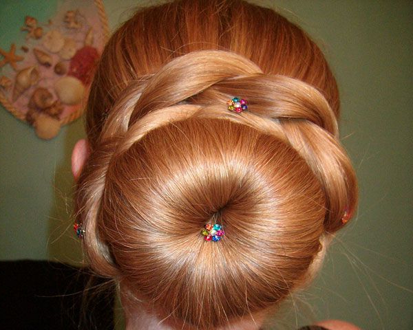 The Fluffy Sock Bun Is Surroundedthick Braids (View 10 of 25)