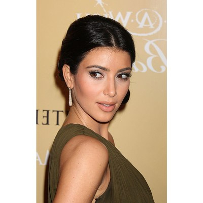The Hair Evolution Of Kim Kardashian Over The Last 10 Years | Allure With Regard To Dishevelled Side Tuft Prom Hairstyles (View 9 of 25)