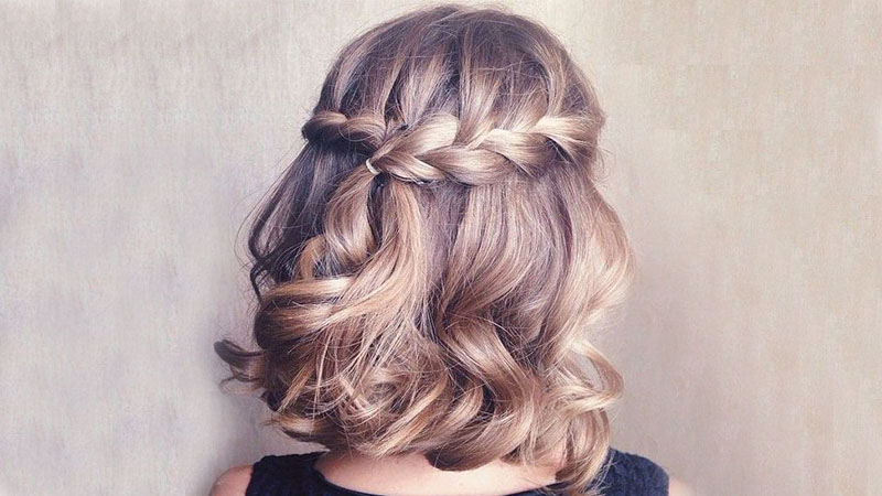 The Most Stunning Prom Hairstyles For 2019 – The Trend Spotter Regarding Chic Waterfall Braid Prom Updos (View 15 of 25)