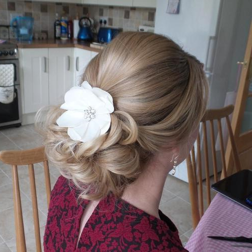 Featured Photo of Low Petal Like Bun Prom Hairstyles
