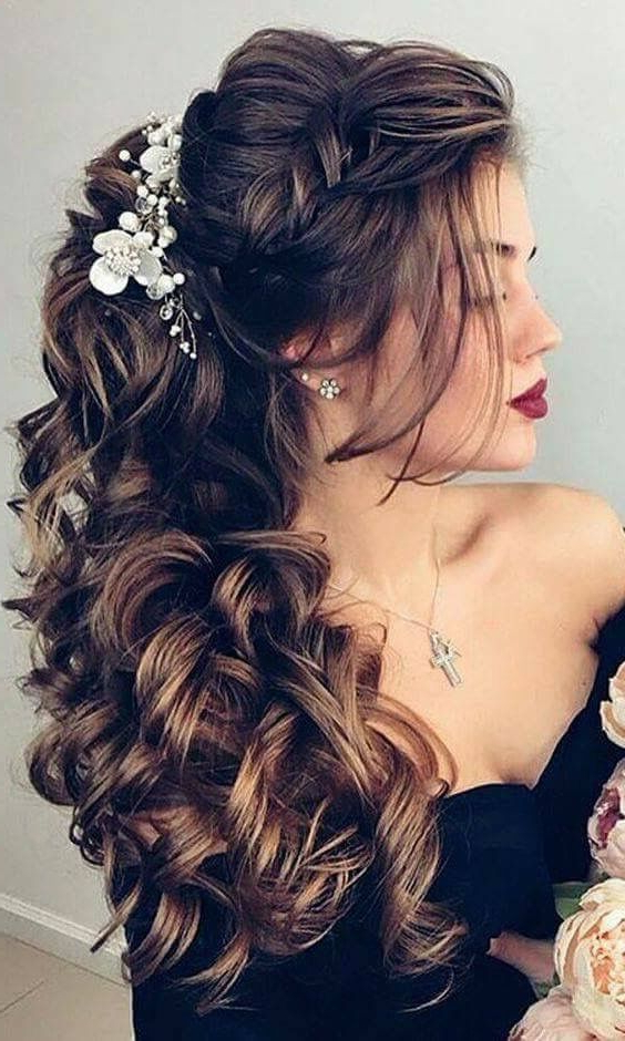 Voluminous, Dark Curls With Flower Accents | Wedding Hair With Voluminous Prom Hairstyles To The Side (View 17 of 25)