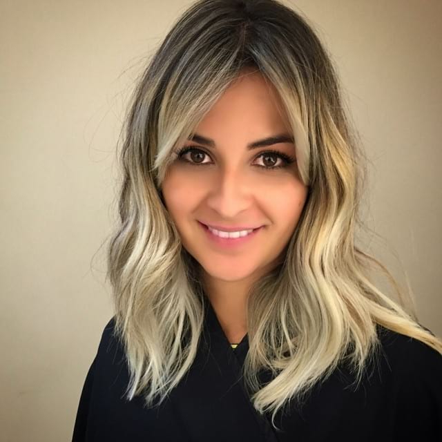 Women's Long Wavy Hair With Center Parted Side Swept Bangs Inside Long Haircuts Side Swept Bangs (View 12 of 25)