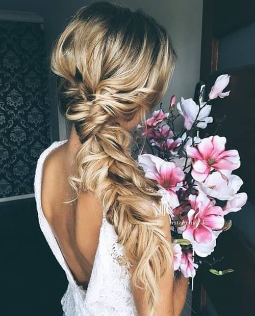 27 Gorgeous Wedding Braid Hairstyles For Your Big Day Within Most Recent Mermaid Fishtail Hairstyles With Hair Flowers (View 11 of 25)