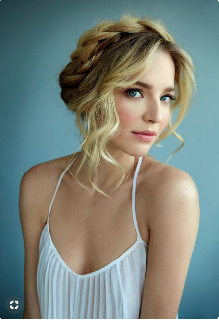 Blonde Woman In A White Tank Top With A Voluminous Halo For Recent Voluminous Halo Braided Hairstyles (View 22 of 25)