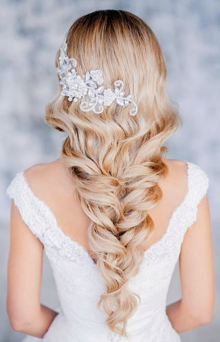 Braided Hairstyles For Weddings Throughout Most Recent Mermaid Fishtail Hairstyles With Hair Flowers (View 19 of 25)