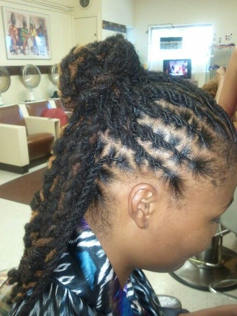 Featured Photo of Tightly Coiled Gray Dreads Bun Hairstyles