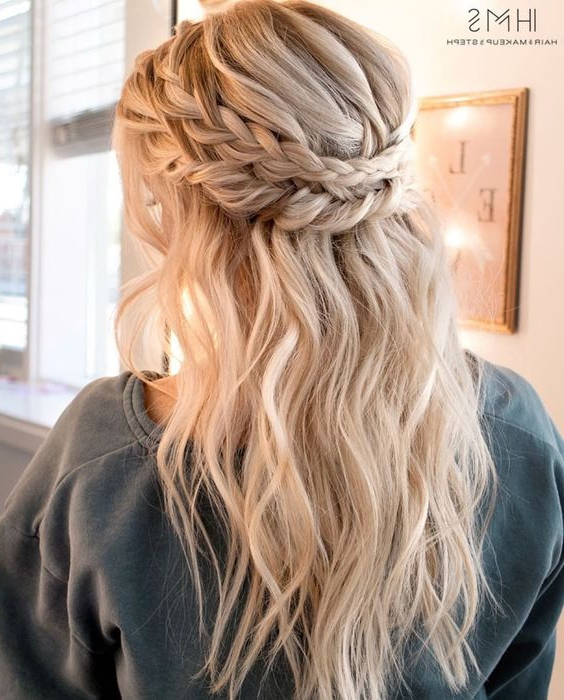 Picture Of A Half Updo With A Double Halo Braid And Textural For Latest Boho Half Braid Hairstyles (View 13 of 25)