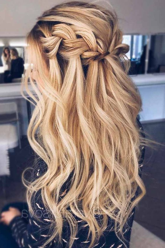 Picture Of A Long Wavy Half Updo Hairstyle With A Braided Throughout Most Recent Half Up Half Down Boho Braided Hairstyles (View 11 of 25)