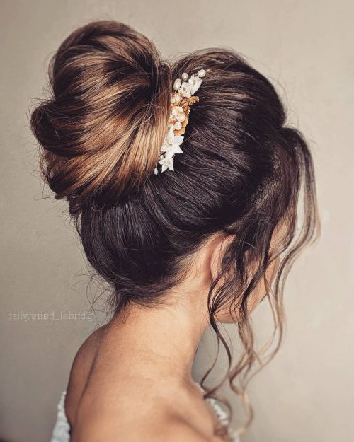 17 Gorgeous Wedding Updos For Brides In 2019 Within High Volume Donut Bun Updo Hairstyles (View 4 of 25)