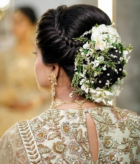 25 Trendy Floral Wedding Hairstyle For Bridal Look For Floral Bun Updo Hairstyles (View 22 of 25)