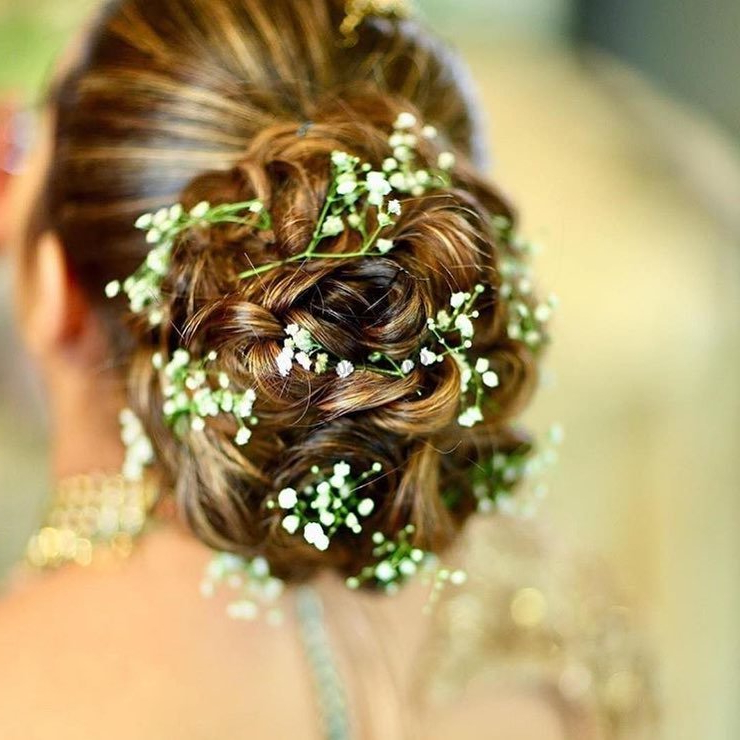 30 Most Beautiful (Floral Bun) Hairstyles We Spotted On Brides! For Floral Bun Updo Hairstyles (View 3 of 25)
