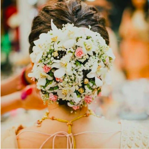 30 Most Beautiful (Floral Bun) Hairstyles We Spotted On Brides! Throughout Floral Bun Updo Hairstyles (View 8 of 25)