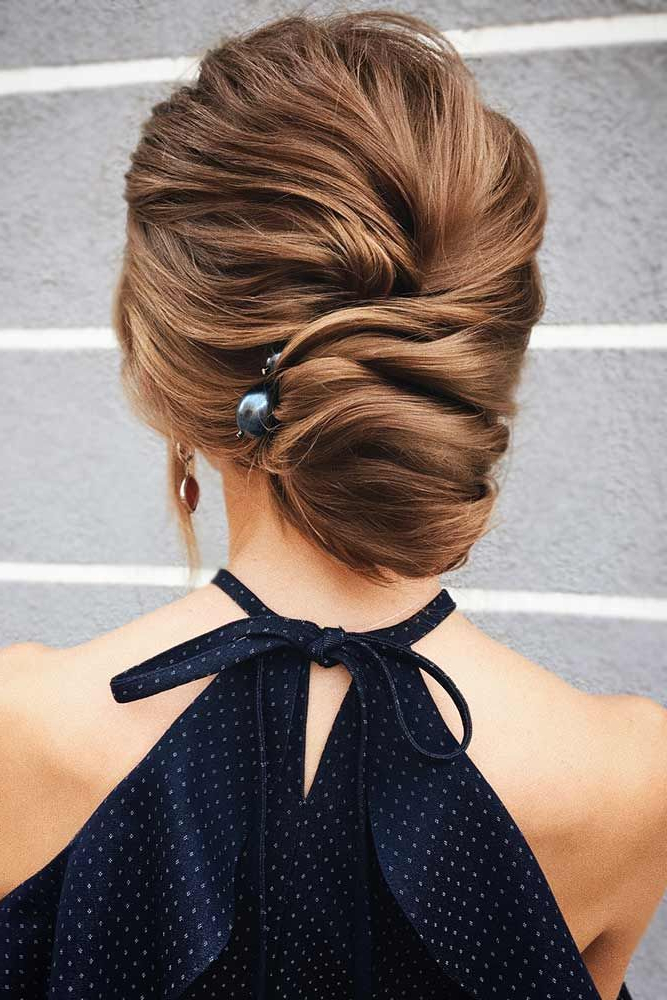 Best Hairstyles & Haircuts For Women In 2017 / 2018 : A Low Within Pearl Bun Updo Hairstyles (View 4 of 25)
