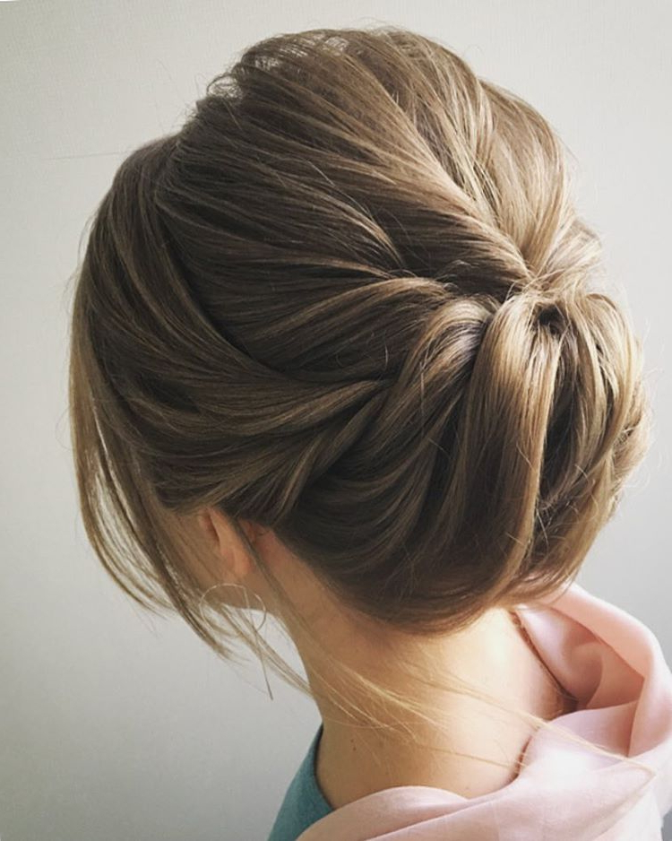 Easy And Pretty Chignon Buns Hairstyles You'll Love To Try Within Swirl Bun Updo Hairstyles (View 11 of 25)