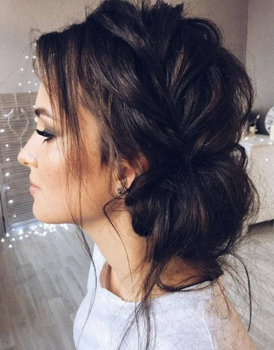 Picture Of A Loose Braided Side Swept Updo With Some Locks Regarding Side Swept Braid Updo Hairstyles (View 12 of 25)
