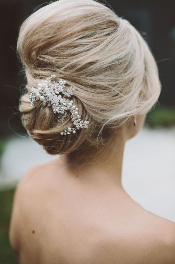 Picture Of An Elegant Wedding Updo Hairstyle With Pearl Intended For Pearl Bun Updo Hairstyles (View 22 of 25)