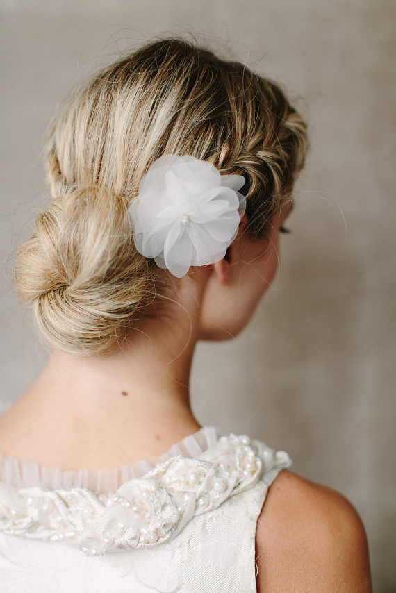 Romantic Low Braided Bun Updo With Silk Flower – Hairstyles Intended For Floral Bun Updo Hairstyles (View 9 of 25)