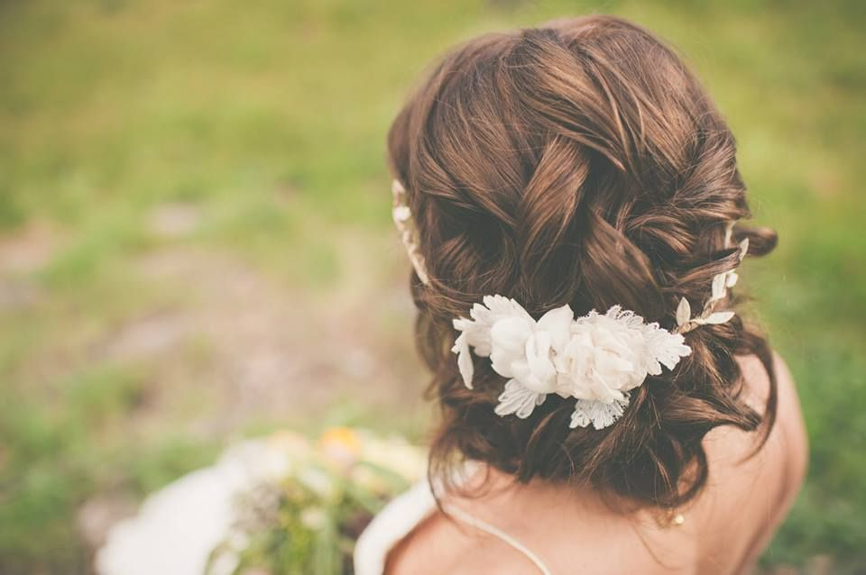 Romantic Wedding Updo With A Bohemian Floral Crown Regarding Romantic Florals Updo Hairstyles (View 20 of 26)