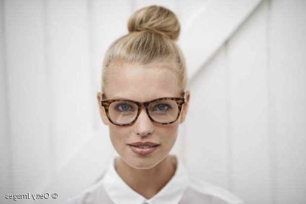 Street Style Hair Inspiration: High Volume Bun Updo Pertaining To High Volume Donut Bun Updo Hairstyles (View 12 of 25)